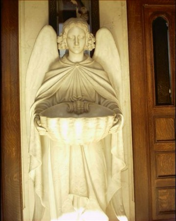 angel at the entrance of St. Peter & Paul where Howard Hart attended mass every day. Photo by T. Walden.