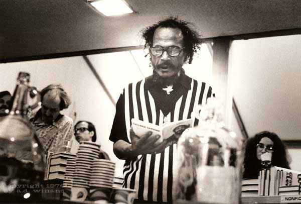 Bob Kaufman at Second Coming Poetry reading celebrating the release of California Bicentennial Poets Anthology, at Books Plus in SF, 1976. Copyright A.D. Winans.