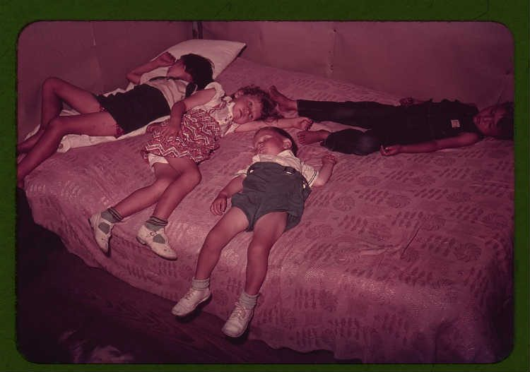 Russell Lee - Children asleep on bed during square dance, McIntosh County, Okla. - 1a34095v